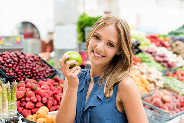 Blonde woman shopping organic veggies and fruits
